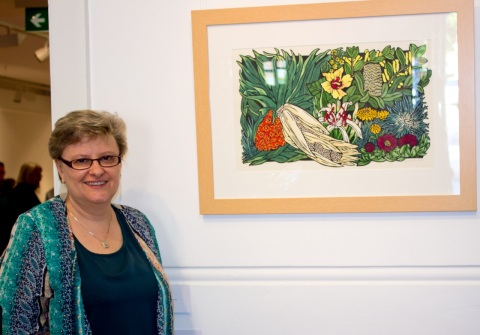 Lynette Weir with 'Seaside Wildflowers' exhibition centrepiece - Limited Edition Handcoloured Linocut - Northern Rivers Community Gallery, Ballina NSW