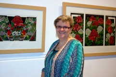 Lynettte Weir with two of her linocuts - Blue Mountains Wildflowers & Waratah Tryptich