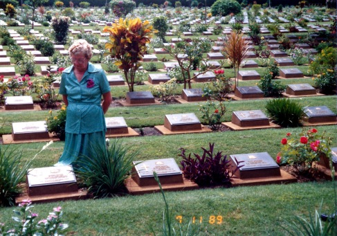 Elsie MATTHEWS nee VIDLER - Sister of George Thomas Vidler visiting his memorial in Kanchanaburi Cemetary in Thailand in 1989